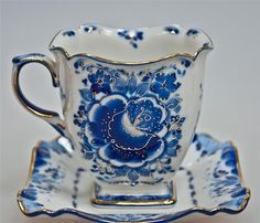 Tea cup with square saucer; blue and white with gold trim-- Love it!