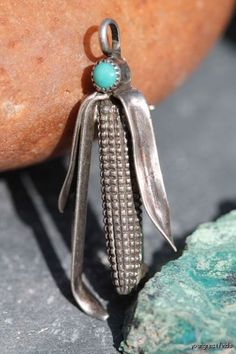 Ear of corn adorned with a turquoise bead. Vintage Southwestern Navajo Sterling Silver charm/pendant