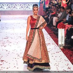 Neha Dhupia showcases a design by jewellery designer Gitanjali Gems during the India International Jewellery Week (IIJW), held at Grand Hyatt, Mumbai, on August 06, 2013.