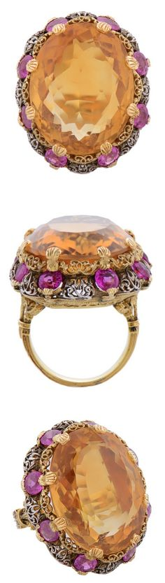 Buccellati Two-Colour Citrine Pink Sapphire Gold Cocktail Ring, An Intricate Two-colour gold Citrine & Pink Sapphire Cocktail Ring, by Buccellati, Italian, circa 1950, eight claw-set at the centre with an oval mixed-cut stone estimated to weigh 25cts, the fine scroll carved openwork crown, gallery & shoulders setting set with 8 circular-cut pink sapphires.Circa 1950s.