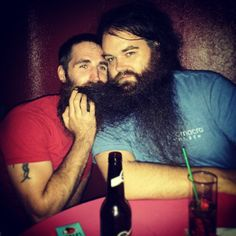 Big beard generously sharing Beardspiration with another bearded brother.
