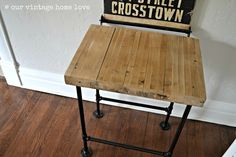 table crafted from salvaged bowling alley flooring & plumbing pipes