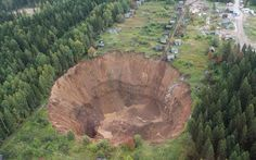Sinkholes, craters and collapsed roads from around the world (pictures) ... (Siberian ones appears something came OUT!)