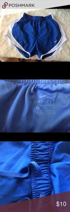 Woman's Nike Running Shorts Royal Blue with White Trim In excellent condition other then the tiny blue dot on back bottom of shorts:  pictured above Nike Shorts