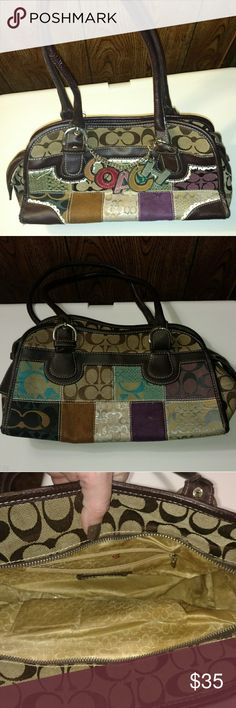 Coach purse Medium sized, colorful Coach purse with COACH letters dangling on front. Has a slight smoke smell from Person I bought it from. Coach Bags