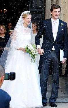 Miss Elisabetta Maria Rosbach von Wolkenstein married Prince Amedeo of Belgium on July 5, 2014 at the Basilica Santa Maria in Trastevere in Rome, Italy. The bride's gown was designed by the Italian fashion designer, Valentino Garavani, and was from the collection Haute Couture. The gown was made from ivory point d'esprit tulle with rebrode lace embellishments, and she topped it with a 16 foot point d'esprit tulle veil with motifs of Chantilly lace. Her veil was held in place with Queen…