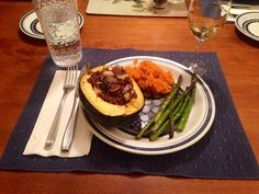 A vegan thanksgiving. Stuffed acorn squash with maple mashed sweet potatoes and roasted asparagus.