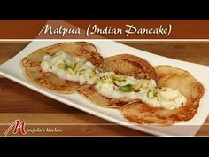 Malpuas are Indian version of pancake topped with reduced flavored milk known as rabdi. This is a mouth watering classic Indian dessert made for festive occasions. Vegan Indian Recipes, Indian Dessert Recipes, Sweets Recipes, Vegetarian Cooking, Vegetarian Recipes, Indian Pancakes, Kitchen Recipes, Cooking Recipes, Pancake Dessert
