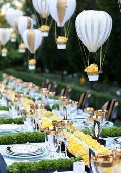 Hanging Mini hot air balloon wedding reception centerpiece. Very unique.