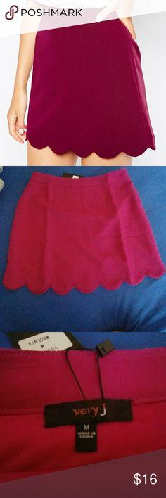 NWT scalloped skirt NWT scalloped skirt. Back zipper. 100% polyester. Magenta color Very J Skirts Mini