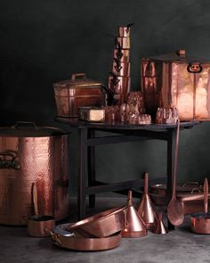 A few items from Martha's collection show the variety of shapes and sizes of copper cookware. The huge hammered stockpot (it's about 30 inches tall!), below left, is a favorite of hers. The large antique English skimmer, right, is a rare find.