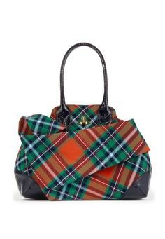 For Autumn/Winter 2013-14 Vivienne Westwood returns with her Winter Tartan Collection. Beautifully crafted in Classic tartan, this elegant Winter Tartan Bag comes designed with beautiful folded fabric concealing a secret pocket. With the golden Orb to the front, this bag unzips to reveal Vivienne's famous grey scribble orb lining, two open pockets and one zip closing compartment.