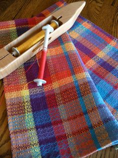 Tea towel designed and handwoven with a rainbow of bright fiesta colors in a fancy twill weaving pattern with 100 percent cotlin. This type