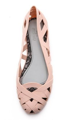 Fun textured pink ballet flats. Looks like ribbons.