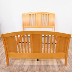 """This simple contemporary bed frame fits a queen sized mattress. The frame is stained in a blonde finish with some wear. The sleigh bed is made of solid wood. Please see our listing for the matching bedroom set!    Dimensions: 61.5""""L x 97""""D x 53""""H #contemporary #beds #bedframe #sandiegovintage #vintagefurniture"""
