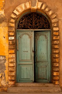 .This old door brings forth a warm feeling wishing I was at the door; touching it, entering...
