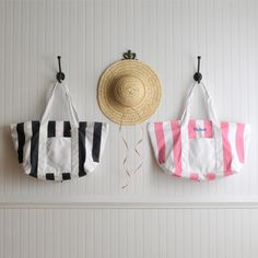 """Our pink and white personalized Candy-striped Tote Bag adds a touch of femininity to any outfit. Use it for a day at the beach, a quick trip on a plane, or just as an everyday purse. This roomy bag has handles long enough to carry on the shoulder, a zipper for keeping essentials inside, and a small outside pocket for those items that require quick retrieval. Personalize with up to 3 initials. Measures 23"""" x 12 1/2"""" x 6"""". Embroidered with three-letter monogram"""