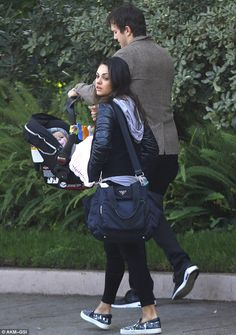 Happy family: Mila was spotted out with her fiancee Ashton Kutcher and baby Wyatt in Los A...