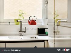 This clean, sleek, white kitchen has little splashes of colour that add depth, style and warmth to the kitchen.
