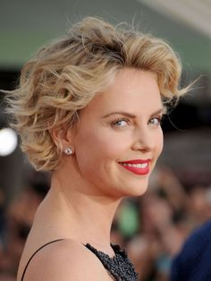 Charlize's waves solve the problem of a too-long pixie. Get the effect at home by sleeping in foam rollers with hair curled away from your face or by using a curling iron. Spritz with hairspray and scrunch for a loose, bouncy effect.