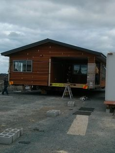 Cedar home on truck for moving