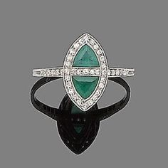 An early 20th century emerald and diamond ring