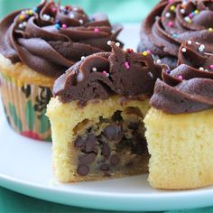 """Chocolate Chip Cookie Dough + Cupcake = The BEST Cupcake. Ever. I """"OH MY!! A sweet little treasure inside these cupcakes makes me smile! I love cookies. I mean really, they're possibly the best thing ever..and to combine them w/ a cupcake. True genius!"""""""