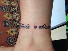Anklet tattoo of my girls names. On other side is Amber and Scarlett