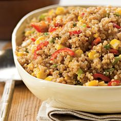 This #Southwestern dish combines protein-packed #quinoa, fiery spices, and corn. Plus, it's under 220 calories per serving! #vegetarian | Health.com