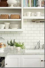 Kitchen: Kitchen Close Up Backsplash White Subway Tiles Dark Grey Grout Open Shelving Shelves Marble Countertops White Cabinets Off White Kitchen Tiles Off White Warm Beige Hand Painted Subway Mosa, Your Kitchen More Beautiful With Off White Subway Tile I White Cabinets White Countertops, Marble Countertops, Open Cabinets, Dark Cabinets, Dark Counters, Maple Cabinets, Shaker Cabinets, Laminate Countertops, New Kitchen