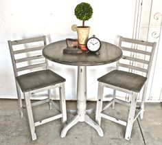 Barstool table and chairs painted with French Linen Chalk Paint, distressed and then sealed with clear wax. Tops were painted with a Coco and Graphite wash and sealed with clear and black wax. Done by Yesterday's Treasures by Maddy. Visit my Facebook page! https://www.facebook.com/Yesterdays-Treasures-by-Maddy-520858771365674/?pnref=story