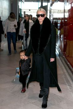 Kim Kardashian and her daughter, North West, at Charles-de-Gaulle airport in Paris on March 12, 2015.