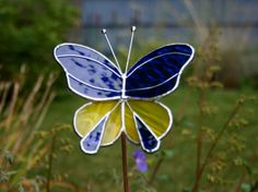 Stained Glass Butterfly Garden Ornament, Royal Blue and Yellow. $20.00, via Etsy.