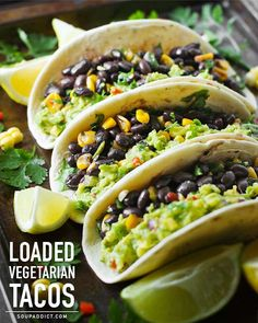 Loaded Guacamole Vegetarian Tacos - Veggie-loaded guacamole tacos with black beans, corn, and peppers. Vegetarian, vegan, and full-on yummy. Recipe at SoupAddict.com
