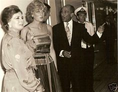 Diana and Charles during their honeymoon entertained aboard ship Mr. & Mrs. Anwar Sadat of Egypt for dinner.