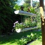Hanging gutter garden - pretty cool.