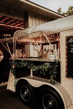 Vintage horse trailer that was converted into a mobile bar for weddings and events. - Vintage horse trailer that was converted into a mobile bar for weddings and events.