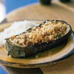 Eggplant makes a satisfying vegetarian dinner when stuffed with tomato and peppers and served with rice. Feta cheese adds tang and body to the stuffing.