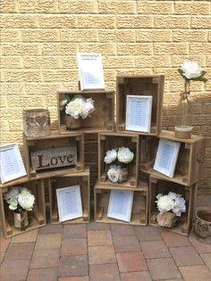 Wedding seating plan crate display. For hire  9 crates, jars of silk flowers, 2 bark lanterns and frames. More or less frame can be added depending on number of tables you have.  All for £35 hire fee