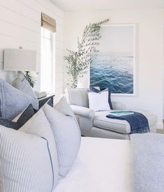 Coastal bedroom with a cozy seating area by the window