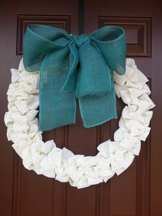 Winter wreath - the white burlap plus teal bow would actually work beautifully with our house
