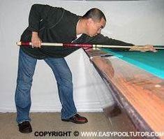 THE POOL STANCE. The main objective of the stance is to provide a solid base that help balance the body's weight thereby minimizing unwanted movement while the player is stroking the cue stick and shooting the ball.