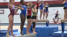 Girls of all ages dance, tumble, vault, and hand-stand their way through gymnastics summer camp at the University of Maryland.