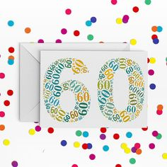 60! This typographic design is perfect for your favourite sexagenarian.  Available in a choice of Yellow, green and blue, or multi colours.   DETAILS - White greetings card with typographic number design - Design printed on photographic paper and applied to 300gsm premium card - With white envelope - Individually packaged in a cellophane sleeve - A6 (105 x 148mm) with C6 (slightly larger than A6) envelope - Blank Inside for your message  Your card will be dispatched first class in a board…