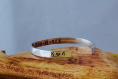 Personalised hand stamped aluminium cuff bangle. by InkandfeatherbyKerry on Etsy