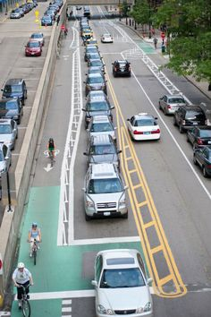 Cyclists on the Kinzie Street protected bike lane in downtown Chicago, IL. Click twice on image for in-depth article on The Rise of The North American Protected Bike Lane. Click image for details & visit our popular Streets for Everyone board >> http://www.pinterest.com/slowottawa/streets-for-everyone/