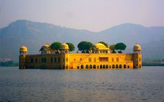"""""""The Jal Mahal palace has got an eye-popping makeover. Traditional boat-makers from Vrindavan have crafted the Rajput style wooden boats. A gentle splashing of oars on the clear lake waters takes you to Jal Mahal. You move past decorated hallways and chambers on the first floor to climb all the way up to the fragrant Chameli Bagh. Across the lake, you can view the Aravalli hills, dotted with temples and ancient forts, and on the other side, bustling Jaipur."""