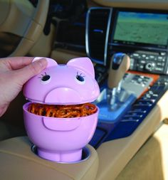 A pig-shaped snack container that fits right into your car's cup holder.