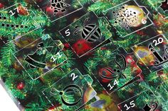 Designed and produced by Glossop Cartons, this is an advent calendar, counting down to Christmas and was printed on metal paperboard. While the printing is the same on the whole sheet, each square has a different cutout, digitally cut & creased on the Highcon Euclid.