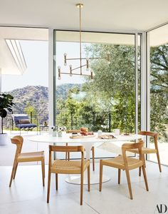 The latest issue of Architectural Digest features the mid-century modern home of actress Mandy Moore. Mid-century modern can feel a. Architectural Digest, Mandy Moore, Mid Century Dining, Mid Century House, Dining Room Design, Dining Room Furniture, Dining Chairs, Furniture Stores, Room Chairs